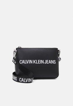 Calvin Klein Jeans - SCULPTED CAMERA POUCH - Sac bandoulière - black