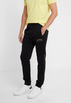 BOSS - HADIKO WIN - Jogginghose - black/gold