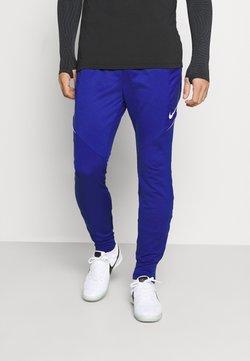 Nike Performance - DRY STRIKE WINTERIZED - Jogginghose - deep royal blue/white
