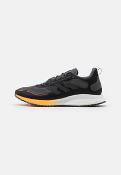 adidas Performance - SUPERNOVA BOOST BOUNCE COLD RDY RUNNING SHOES - Zapatillas de running neutras - core black/night metallic/signal organge