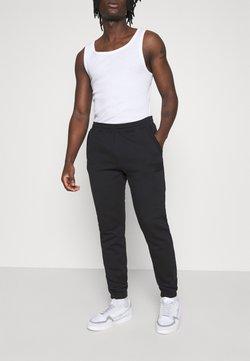 adidas Originals - PANT UNISEX - Jogginghose - black