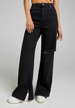 Bershka - Flared Jeans - black