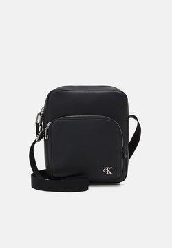 Calvin Klein Jeans - MICRO REPORTER UNISEX - Sac bandoulière - black