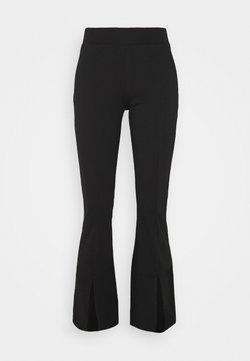 ONLY Petite - ONLCIANA FLARED PANTS - Pantalones - black