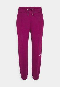 Calvin Klein Jeans - OFF PLACED MONOGRAM PANT - Jogginghose - purple