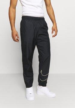 Nike SB - TRACK PANT - Jogginghose - black/fossil