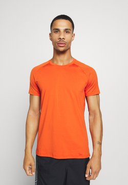 Casall - STRUCTURED TEE - Camiseta básica - intense orange