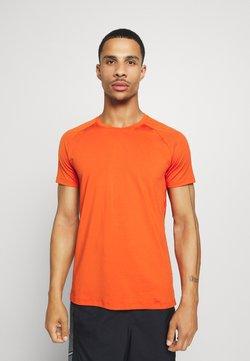 Casall - STRUCTURED TEE - T-paita - intense orange