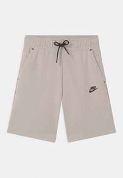 Nike Sportswear - Verryttelyhousut - desert sand/black