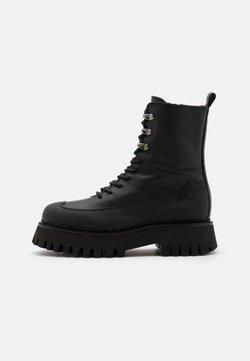 Bronx - GROOV-Y - Enkellaarsjes met plateauzool - black
