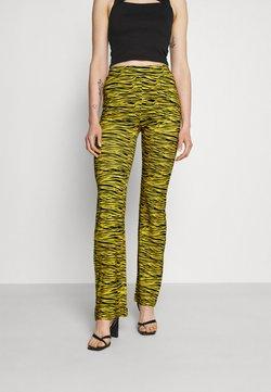 NIKKIE - TIGER FLARED PANTS - Stoffhose - bamboo