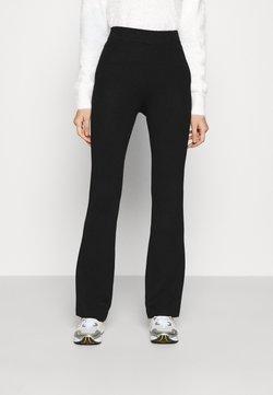 NA-KD - FLARED LOUNGE PANTS - Jogginghose - black