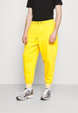 Karl Kani - SIGNATURE - Pantaloni sportivi - yellow