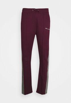 Nominal - CHECK TAPE  - Jogginghose - burgundy