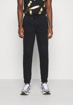 Calvin Klein - GOLD LOGO SWEATPANTS - Jogginghose - black