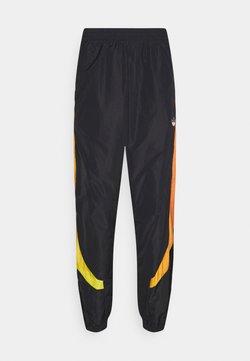 adidas Originals - SPRAY UNISEX - Tracksuit bottoms - black