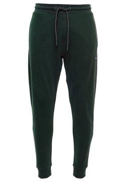 Superdry - Jogginghose - academy dark green