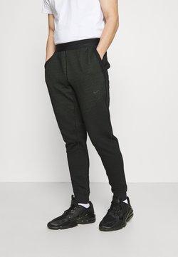 Nike Sportswear - PANT - Jogginghose - black/mean green