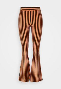 Stieglitz - RAJ FLARED LEGGINGS - Leggings - Hosen - nectarine