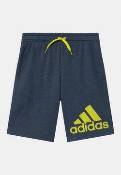 adidas Performance - UNISEX - Pantalón corto de deporte - dark blue/neon yellow