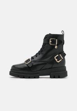 Mexx - FAN - Cowboy/biker ankle boot - black