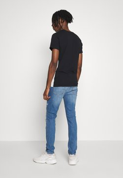 Topman - MID WASH RIP AND REP - Slim fit jeans - blue