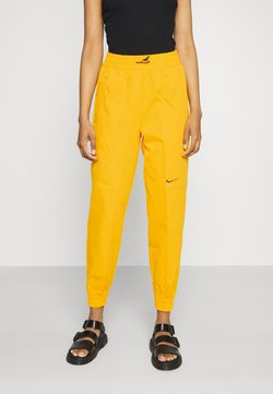 Nike Sportswear - PANT  - Jogginghose - university gold