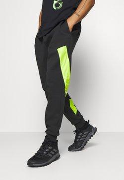 adidas Performance - URBAN PANT - Jogginghose - black/neon green