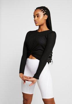 Onzie - TWIRL  - T-shirt à manches longues - black