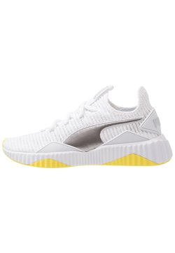 Puma - DEFY TZ - Zapatillas de running neutras - white/blazing yellow