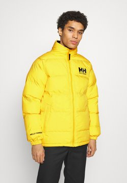 Helly Hansen - REVERSIBLE PUFFER JACKET - Winterjacke - young yellow