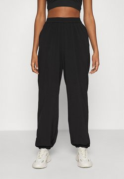 NA-KD - NA-KD X ZALANDO EXCLUSIVE - SPORTY FABRIC PANTS - Jogginghose - black