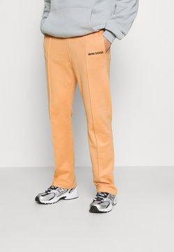 9N1M SENSE - LOGO PANTS UNISEX - Jogginghose - apricot/black
