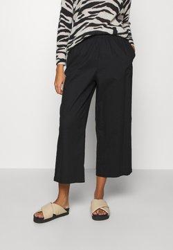 Monki - VILJA TROUSERS - Spodnie materiałowe - black dark