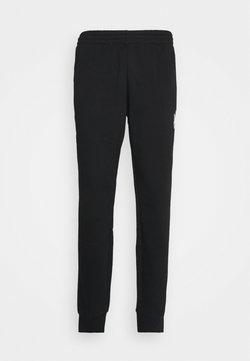 adidas Originals - UNISEX - Jogginghose - black