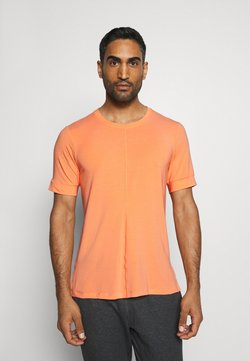 Nike Performance - DRY YOGA - Camiseta básica - orange frost/black
