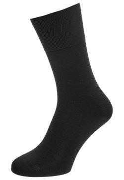 FALKE - AIRPORT - Socken - schwarz