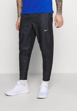 Nike Performance - SHIELD - Jogginghose - black/reflective silver