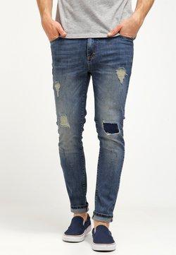 Pier One - Slim fit jeans - destroyed denim