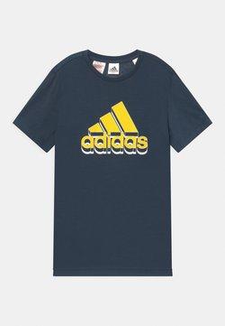 adidas Performance - UNISEX - T-shirt med print - dark blue/yellow