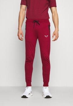 SQUATWOLF - STATEMENT CLASSIC - Jogginghose - red