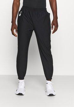 Under Armour - RUN ANYWHERE PANT - Spodnie treningowe - black