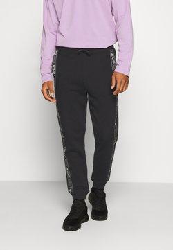 Tommy Jeans - TAPE  - Jogginghose - black