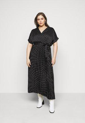 klänningar för storvuxna