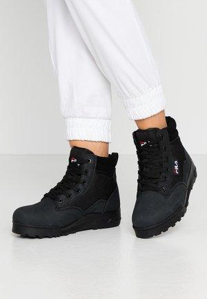 Fila Boots online på Zalando – Köp skor för dam & herr på