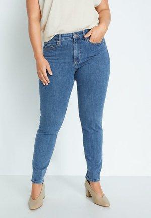jeans stora storlekar dam