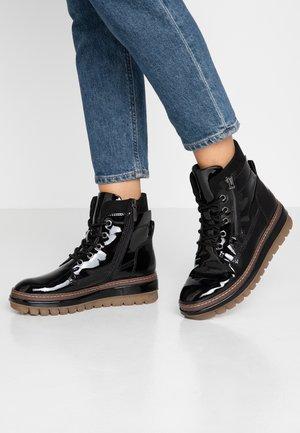 Tamaris Lack Stiefel Größe 42 bestellen bei Zalando